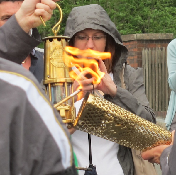 Flame transferred from torch to lamp