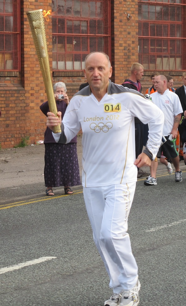 Phil carrying the flame